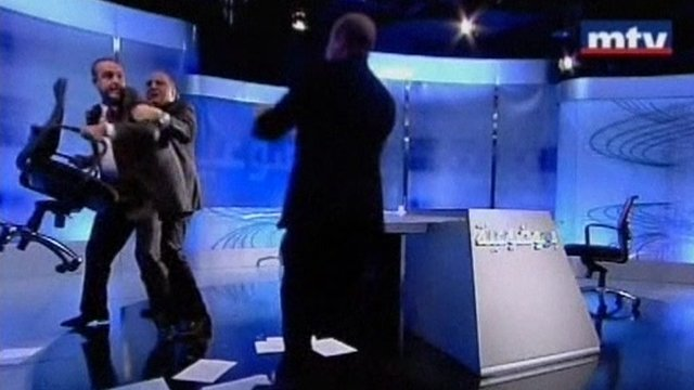 Mans picks up studio chair in TV debate turned sour