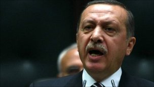 Turkey&#039;s Prime Minister Recep Tayyip Erdogan addresses members of his AK Party at the parliament in Ankara, 15 November.