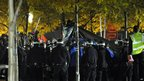 "New York Police Department officers surround a tent as they clear the ""Occupy Wall Street"" protest from Zuccotti Park"