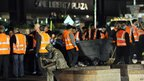 New York City sanitation workers clear the &quot;Occupy Wall Street&quot; protest from Zuccotti Park