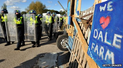 Riot police next to We Love Dale Farm sign