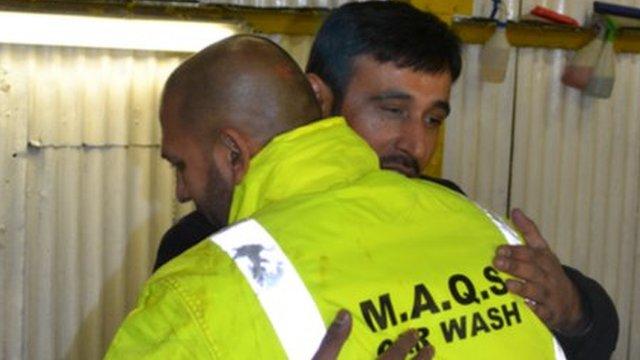 Abdul Quddoos (left) embraces Mohammed Akhtar (right)