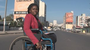 Mariana Tembe crossing the road in Maputo