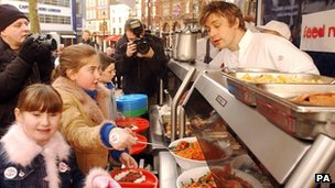 Jamie Oliver feeds children