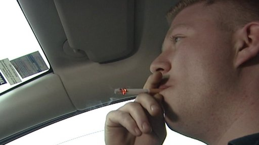 person smoking in car