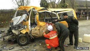 Investigators examine the bus in  Zhengning county on 16 November 2011