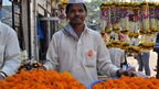 Man selling orange marigolds