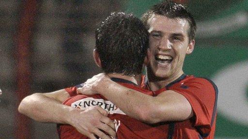 Coleraine players celebrate their 2-1 win over Glentoran in the League Cup quarter-final