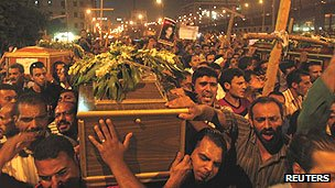 Egyptian Coptic Christians carry coffins to mass funeral for victims of sectarian clashes with soldiers in October 2011