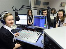 Students inside a radio studio
