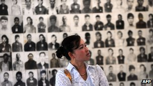 File image of a Cambodian woman looking at images of those who died at Tuol Sleng prison