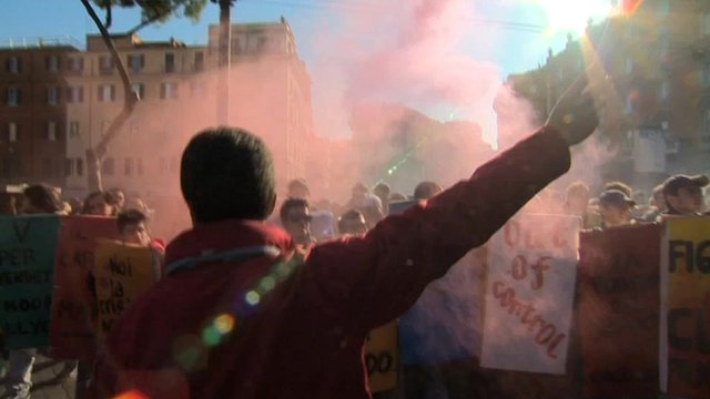 Man waving flare as students protest in Italy