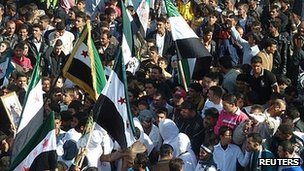 Demonstrators protest against Syria's President Bashar al-Assad in Hula, near Homs. 13 Nov 2011