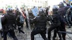 Protesters clash with police on 17 November 2011 in Milan