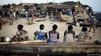 Women sit on a fishing boat in the Akpakpa neighbourhood of Benin's capital Cotonou