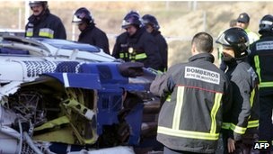 Emergency workers inspect the wreckage of the helicopter in Mostoles, 1 December 2005