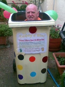 Ted Mountain in a wheelie bin