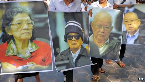 Cambodian students hold portrait photos of former Khmer Rouge leaders at an outreach programme in Phnom Penh on 18 November 2011