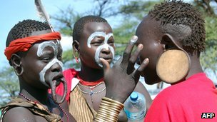 Young Mursi women ready themselves for a tribal ceremony in the South Omo River valley of Ethiopia