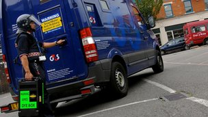 G4S van and guard
