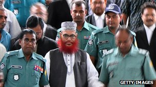 Delwar Hossain Sayedee (C) emerges from the Bangladesh International Crimes Tribunal in Dhaka on August 10, 2011