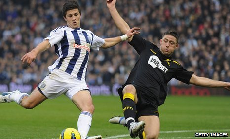 Bolton's Gary Cahill blocking West Brom's winning scorer Shane Long