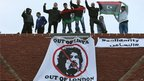 Protesters on the roof of a London house thought to belong to Saif al-Islam (09 March 2011)