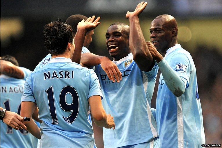 Micah Richards celebrates with teammates