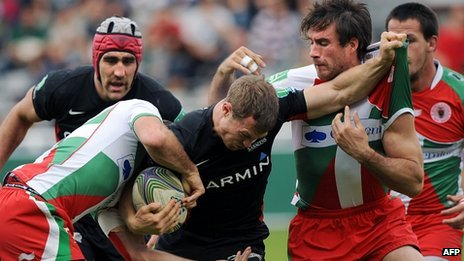 Saracens' James Short fights off Biarritz's tacklers