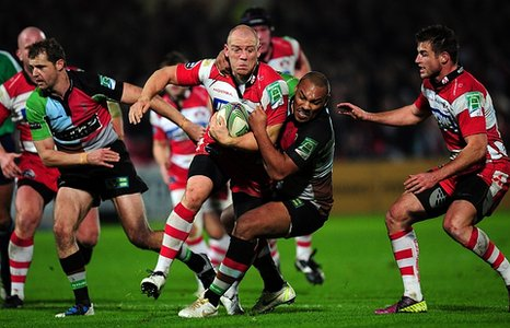 Gloucester's Mike Tindall tries to evade Harlequins' Jordan Turner-Hall