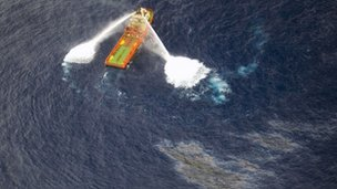 A supply boat working around the oil spill off the coast of Brazil