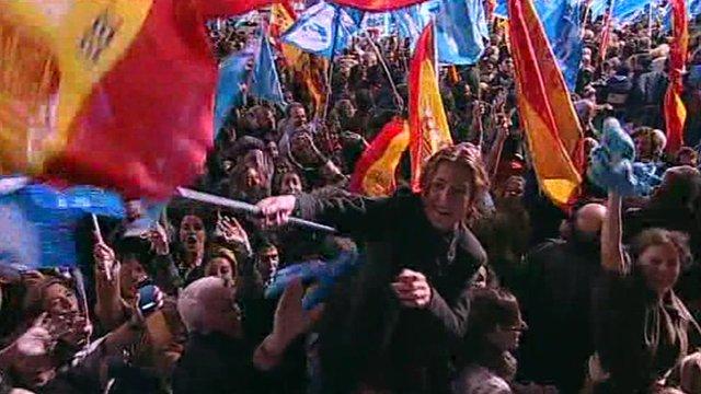 Spanish conservative waves Spanish flag amid jubilant crowd