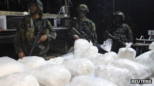 Colombian anti-drugs police guard a cocaine laboratory in the town of Guaracu, Puerto Gaitan province in Meta, 13 October 2011