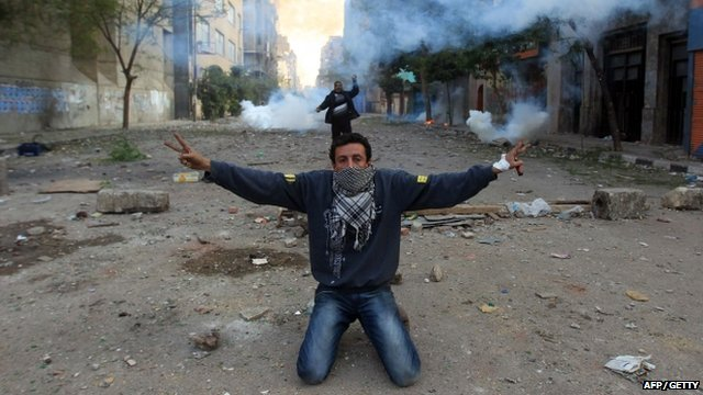 An Egyptian protester shows the V-sign for victory