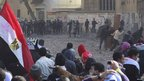 Protesters and police face each other in Tahrir Square, Egypt
