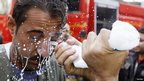 A protester's eyes are washed with milk to protect against tear gas in Cairo, Egypt