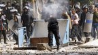 A riot policeman fires rubber bullets in Cairo, Egypt