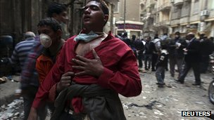 Injured protester led away in Cairo. 21 Nov 2011