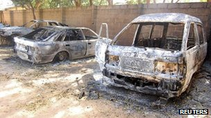 Burnt out vehicles in a church compound after the attack in Damaturu, north-east Nigeria, 8 November 2011