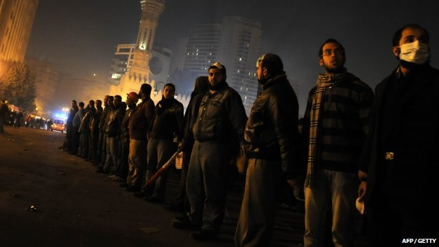 Protesters standing in a line in Tahrir Square