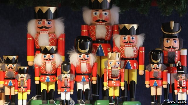 Hand-painted nutcrackers stand among other Christmas ornaments