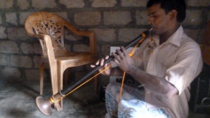 Siva Ruben plays his nadeswaram (oboe)