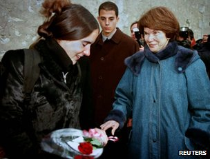 Danielle Mitterrand offers a rose to Mazarine Pingeot at a private family reunion in Jarnac, southern France, 11 January 1997