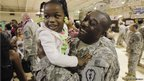 Staff Sergeant Daryll Carlington hugs his daughter after returning from Iraq to his barracks in Wahiawa, Hawaii