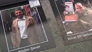 Posters of Ahmet Sik and Nedim Sener