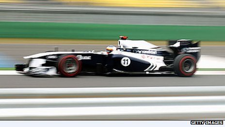 Williams driver Rubens Barrichello in his Randstad branded car