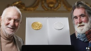 Sir Anthony Caro [L] and Tom Phillips with their gold and silver Olympic UK Kilo coins