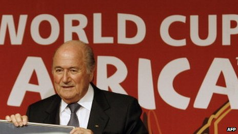 Sepp Blatter in front of a South Africa World Cup poster