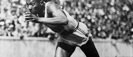 Jesse Owens leaps from the starting line of the 100m dash during the 1936 Olympic Games in Berlin