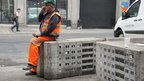 A workman rests on the installation at the Port of London Authority building